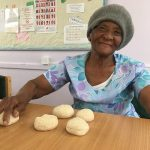 A local resident from the African Caribbean community shaping buns
