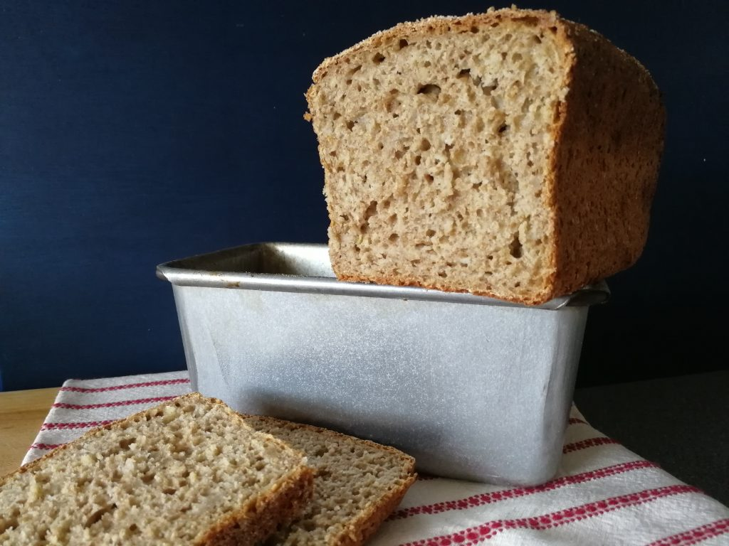 Danish wholemeal loaf on a tin